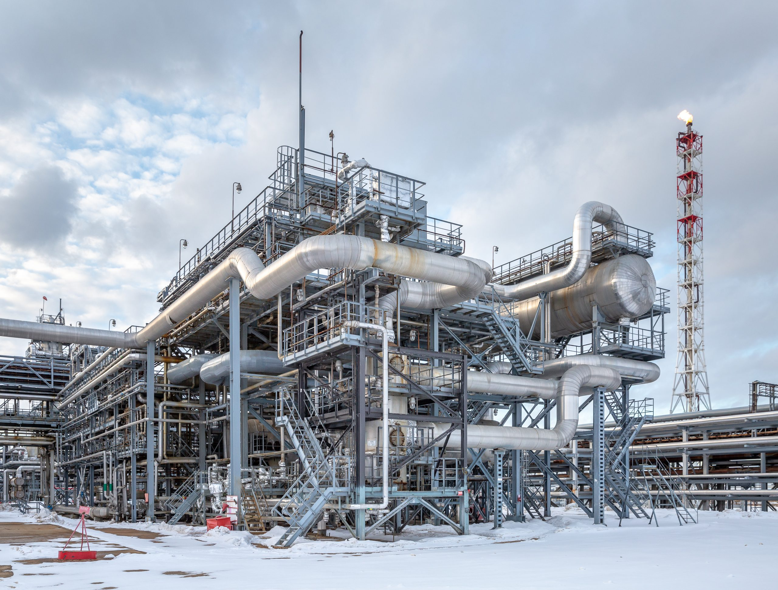 a large, modern petrochemical production in the winter, day time look